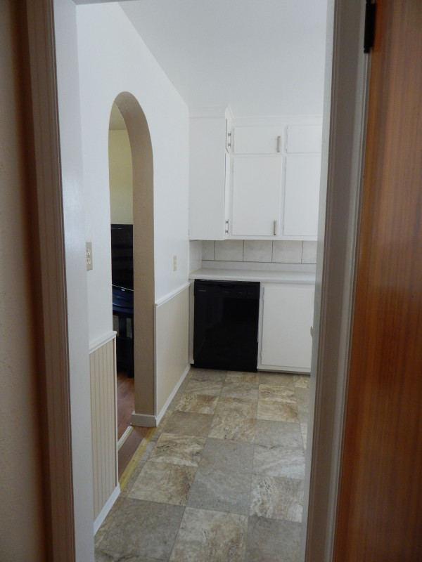 An arched doorway to provide more space